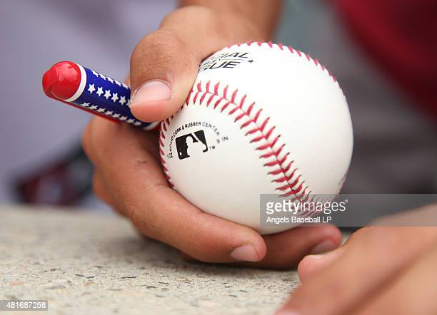 A detailed view of a baseball bearing the MLB Logo before the game between the Boston Red Sox and the Los Angeles Angels of Anaheim at Angel Stadium...