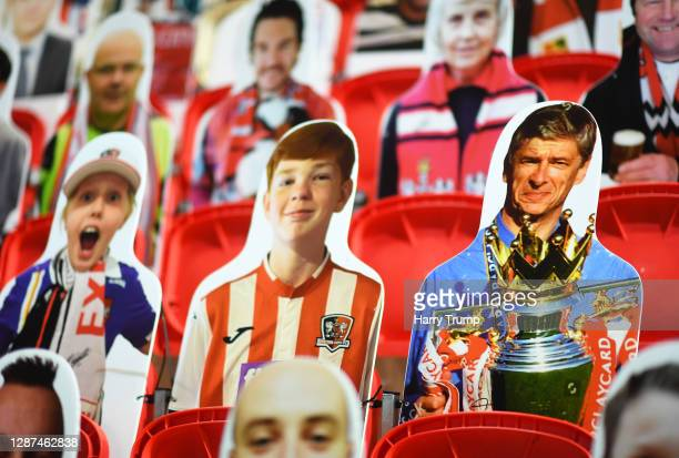 Detailed view of a cardboard cut out of Former Arsenal Manager Arsene Wenger during the Sky Bet League Two match between Exeter City and Colchester...