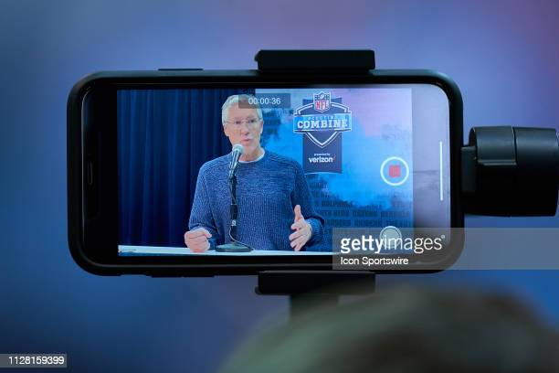 A detailed view of a cell phone recording Seattle Seahawks head coach Pete Carroll speaking to the media is seen during the NFL Scouting Combine on...