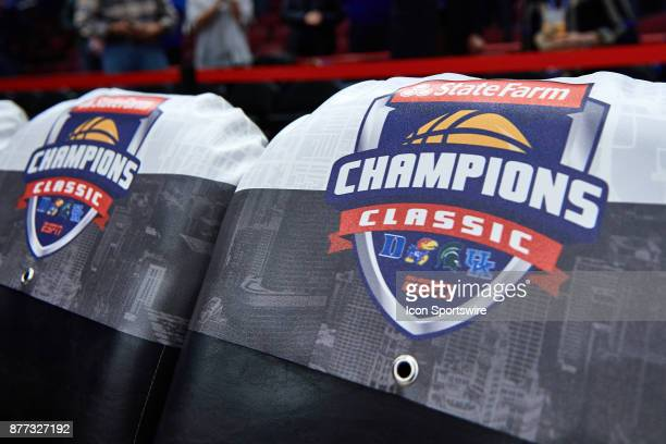 A detailed view of a chair cover showing the State Farm Champions Classic logo is seen during the State Farm Classic Champions Classic game between...