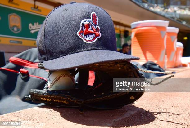 A detailed view of a Cleveland Indians hats with the logo of Chief Wahoo on it in the dugout prior to the start of the game against the Oakland...