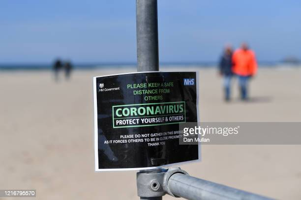 Detailed view of a Coronavirus sign displayed at the entrance to Perranporth beach on April 04, 2020 in Perranporth, England. The Coronavirus...