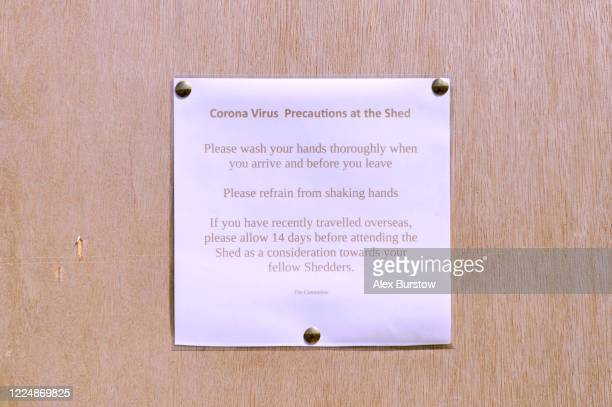 A detailed view of a door sign which displays information about coronavirus precautions to be taken at the Church Crookham and Fleet Men's Shed on...