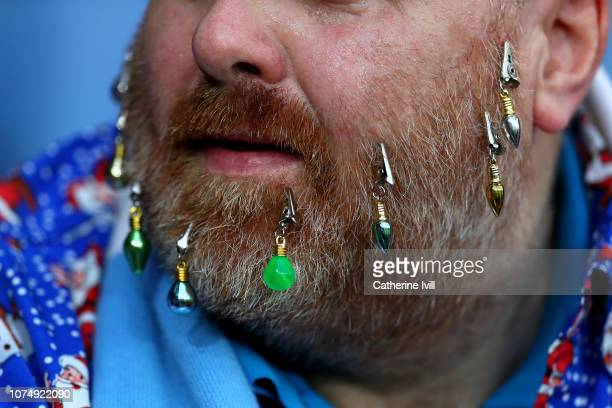 A detailed view of a fans beard decorations prior to the Premier League match between Leicester City and Manchester City at The King Power Stadium on...