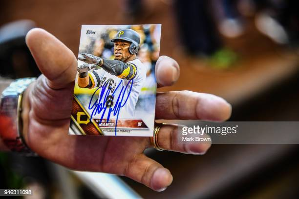 A detailed view of a fans Topps baseball card autographed by Starling Marte of the Pittsburgh Pirates before the game against the Miami Marlins at...