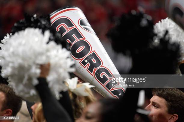 A detailed view of a Georgia Bulldogs cheerleader is seen cheering into a Georgia Bulldogs megaphone during the College Football Playoff National...