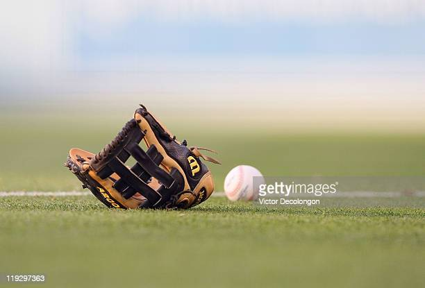 A detailed view of a glove and a ball on the infield prior to the MLB game between the New York Mets and the Los Angeles Dodgers at Dodger Stadium on...