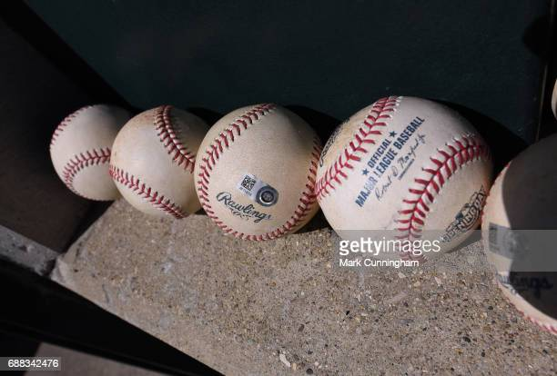 A detailed view of a group of authenticated official Rawlings MLB baseballs sitting in the dugout during the Opening Day game between the Boston Red...