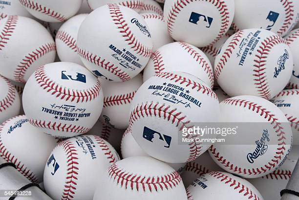 A detailed view of a group of Rawlings official Major League baseballs with the stamped signature of Baseball Commissioner Robert D Manfred Jr shown...