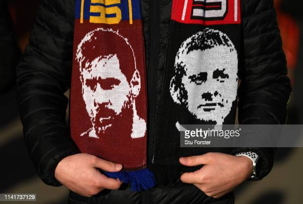 A detailed view of a half and half scarf with the faces of Lionel Messi and Ole Gunnar Solskjaer the UEFA Champions League Quarter Final first leg...