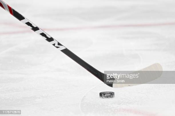 Detailed view of a hockey stick and puck is seen during the first period of a preseason NHL game at Capital One Arena on September 18, 2019 in...