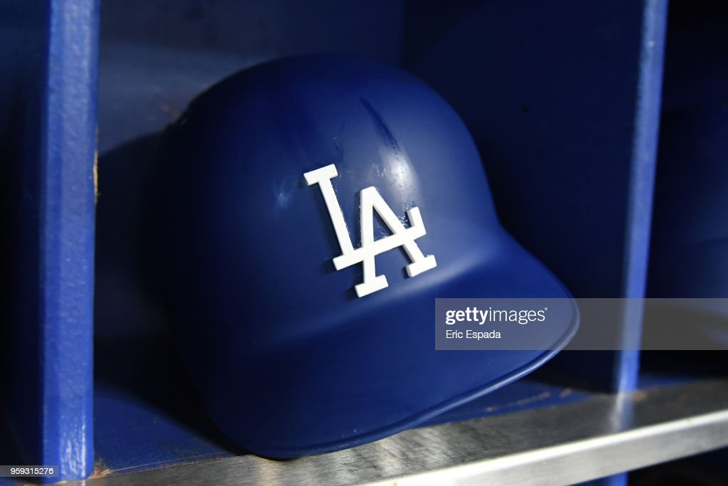 A detailed view of a Los Angeles Dodgers batting helmet in the dugout before the start of the game against the Miami Marlins at Marlins Park on May 16, 2018 in Miami, Florida.
