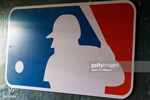 Detailed view of a Major League Baseball logo hanging in a tunnel to the dugout before the game between the Oakland Athletics and the Houston Astros...