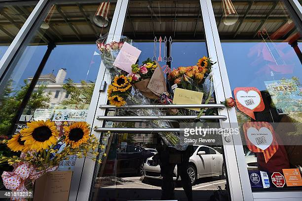 Detailed view of a makeshift memorial in front of a store owned by one of the victims Jillian Johnson on July 24 2015 in Lafayette Louisiana Two...