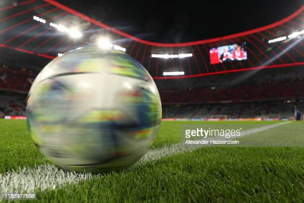 A detailed view of a match ball on the pitch ahead of the UEFA Champions League group B match between Bayern Muenchen and Olympiacos FC at Allianz...