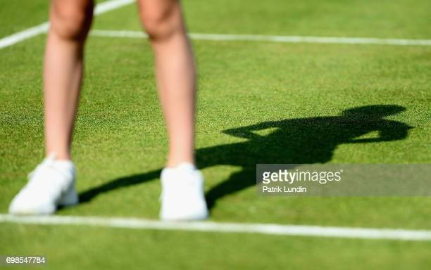 A detailed view of a member of staffs shadow on day two of the 2017 Aegon Championships at Queens Club on June 20 2017 in London England