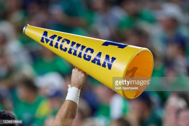 A detailed view of a Michigan Wolverines megaphone is help up by a cheerleader in game action during the college football game between the Michigan...