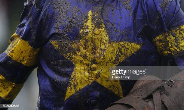 Detailed view of a mud covered Jockeys silks at Exeter Racecourse on January 1 2016 in Exeter England