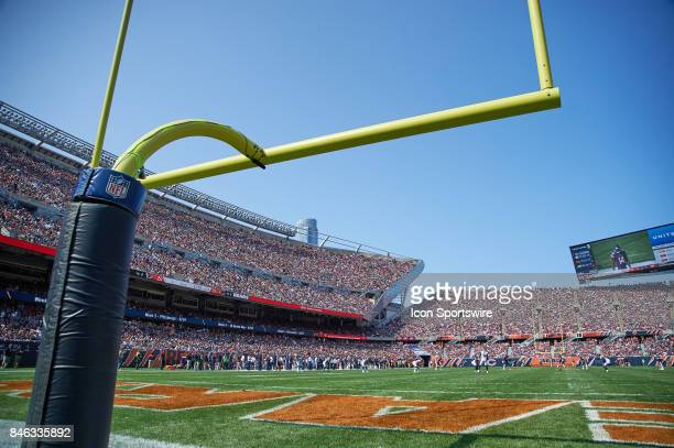 A detailed view of a NFL goal post at Soldier Field with the NFL logo visible around the padding of the post is seen during an NFL football game...