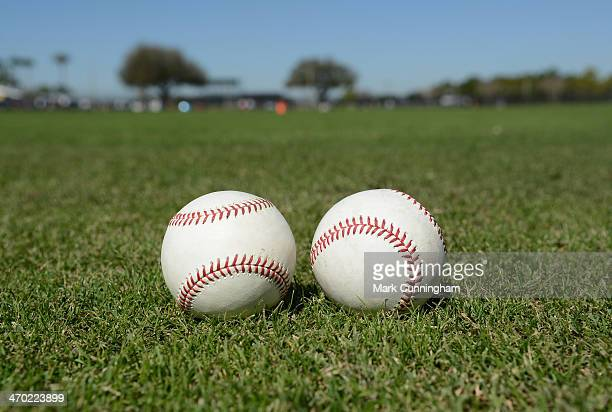 A detailed view of a pair of baseballs sitting on the field during the Detroit Tigers spring training workout day at the TigerTown complex on...