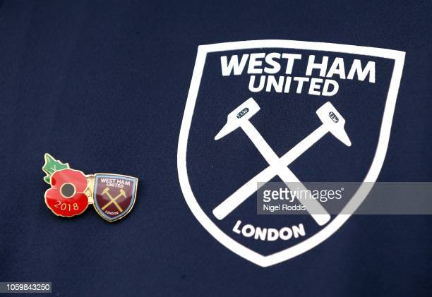A detailed view of a pin badge featuring the Poppy and the West Ham United crest is seen ahead of Armistice Day prior to the Premier League match...