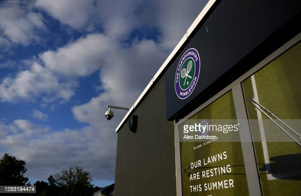 A detailed view of a sign saying 'Our Lawns are resting this summer' outside The All England Tennis and Croquet Club on June 29 2020 in Wimbledon...
