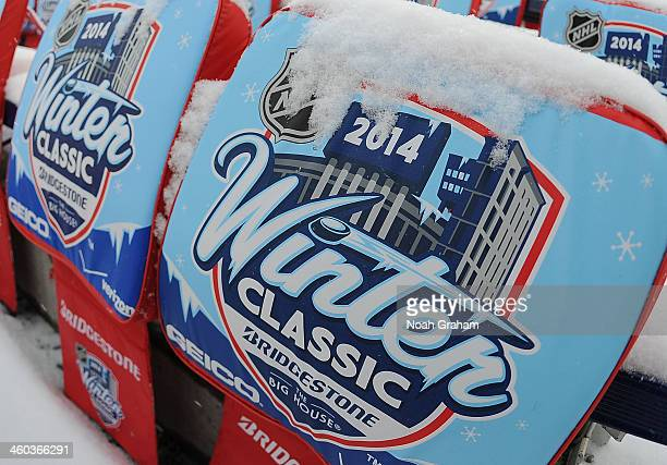 A detailed view of a snowcovered seat cushion is seen covering a seat during the 2014 Bridgestone NHL Winter Classic on January 1 2014 at Michigan...