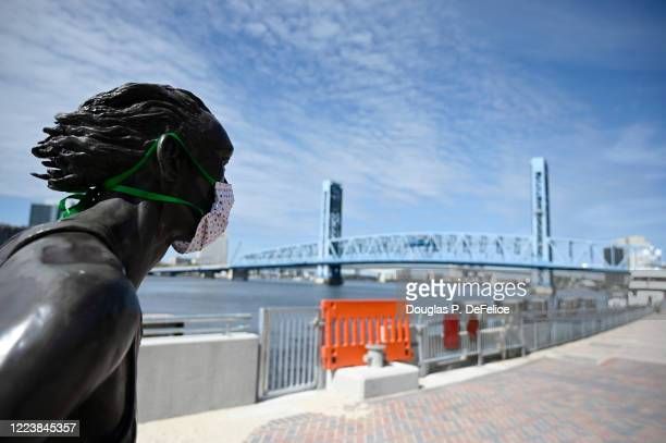 Detailed view of a statue jogger is seen wearing a protective face mask during the coronavirus pandemic on May 09, 2020 in Jacksonville, Florida.