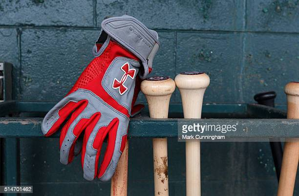 A detailed view of a Under Armour batting glove sitting in the Washington Nationals dugout prior to the Spring Training game against the Detroit...