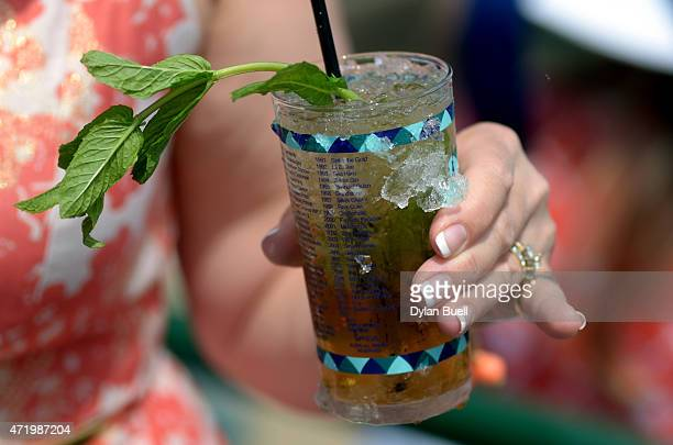 A detailed view of a woman posing with a Mint Julep looks on prior to the 141st running of the Kentucky Derby at Churchill Downs on May 2 2015 in...