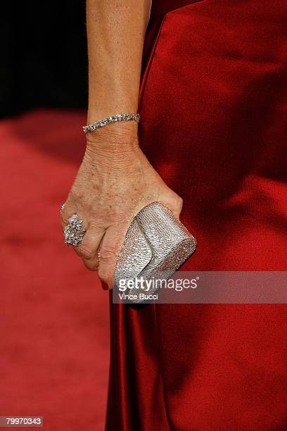 A detailed view of actress Dame Helen Mirren's jewelry and handbag are seen as she arrives at the 80th Annual Academy Awards held at the Kodak...