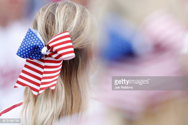 Detailed view of American flag ribbons worn by Indiana Hoosiers cheerleaders during a game against the Wisconsin Badgers at Memorial Stadium on...