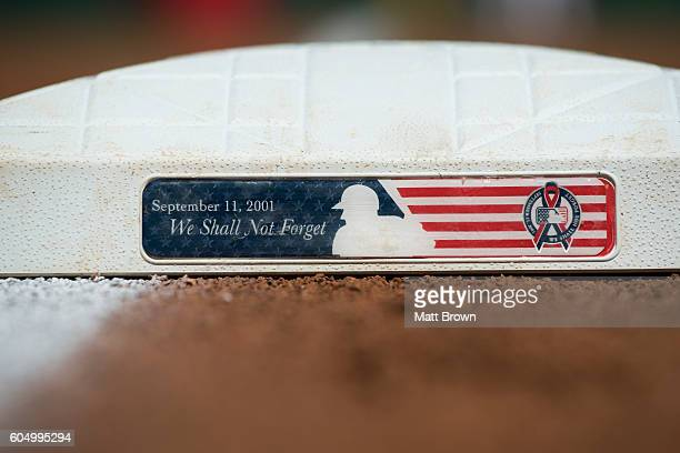 A detailed view of an anniversary of the September 11 2001 terrorist attacks commemorative plaque on a base before the game between the Texas Rangers...
