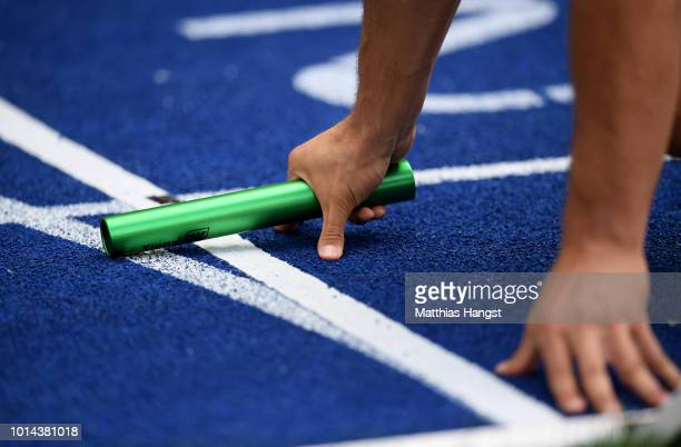 A detailed view of an athlete and baton at the start of the Men's 4 x 400m Relay Qualifying during day four of the 24th European Athletics...