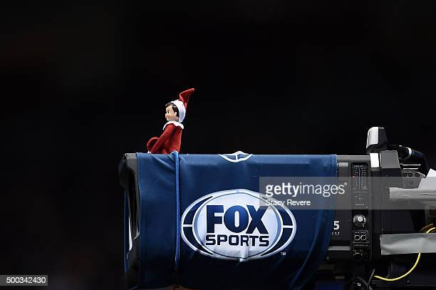A detailed view of an elf sitting on a Fox Sports camera during a game between the New Orleans Saints and the Carolina Panthers at the MercedesBenz...