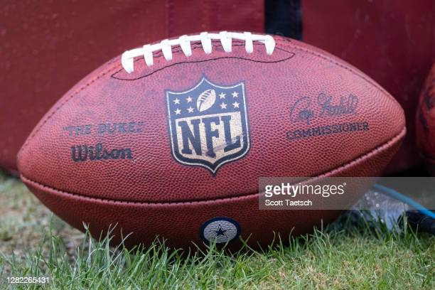 Detailed view of an official NFL football with a Dallas Cowboys logo before the game between the Washington Football Team and the Dallas Cowboys at...