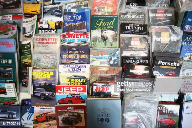 A detailed view of books and magazines with brands like jeep ford landrover porsche vw norton renault vespa and corvette during the The 40th Antwerp...