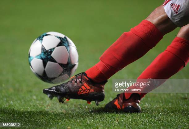 A detailed view of boots kicking the match ball during the UEFA Champions League group A match between SL Benfica and Manchester United at Estadio da...