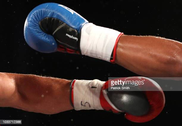 A detailed view of boxing gloves and punches being thrown as Keeshawn Williams exchanges punches with Farhad Fatulla in their Jr welterweights bout...