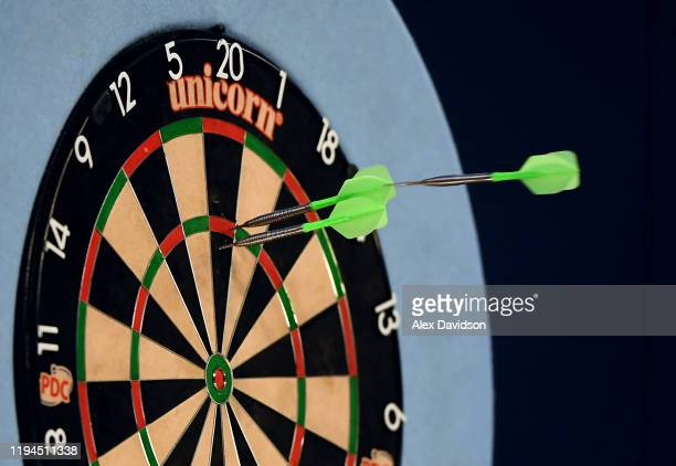 Detailed view of dart hitting the board during Day 5 of the 2020 William Hill Darts Championship at Alexandra Palace on December 17, 2019 in London,...