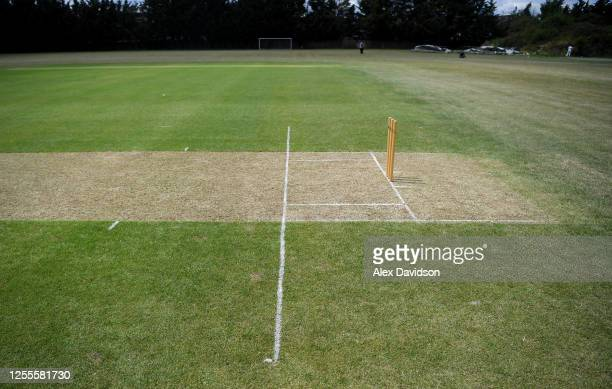 Detailed view of extended crease markings in so batsman can run whilst being socially distant from the bowler at Indian Gymkhana Cricket Club on July...