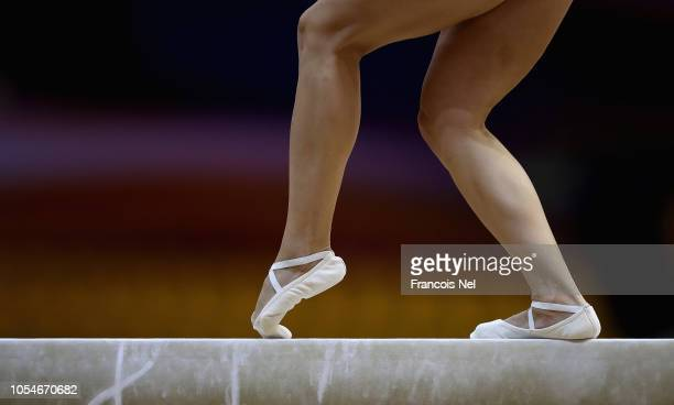 A detailed view of feet on the beam during the Women's Balance Beam Qualification during day four of the 2018 FIG Artistic Gymnastics Championships...