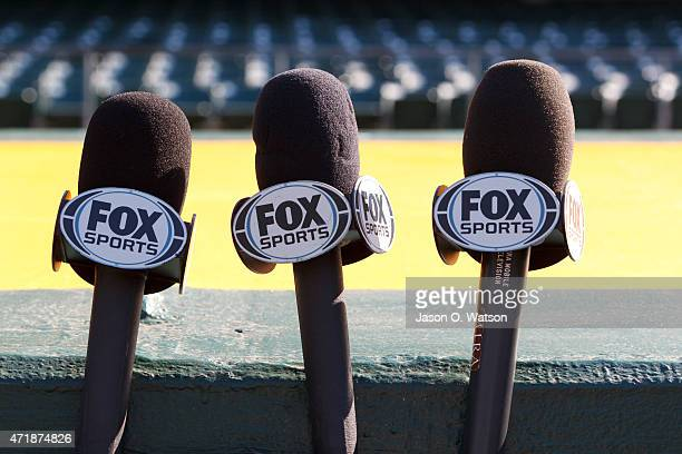 Detailed view of Fox Sports microphones outside the dugout before the game between the Oakland Athletics and the Los Angeles Angels of Anaheim at Oco...