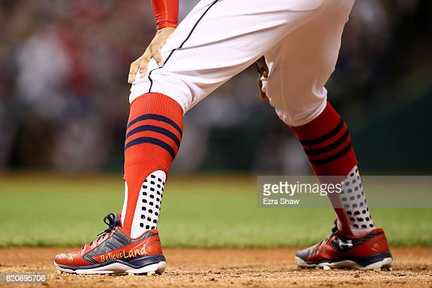 A detailed view of Francisco Lindor of the Cleveland Indians cleats that reads 'BelieveLand' as he leads off of first base against the Chicago Cubs...