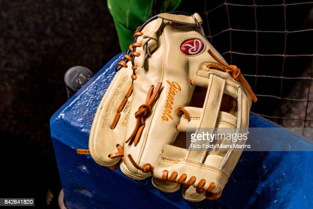 A detailed view of Giancarlo Stanton's glove and bat before the game against the Washington Nationals at Marlins Park on September 4 2017 in Miami...