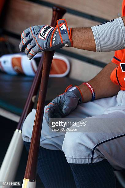 Detailed view of Jose Altuve of the Houston Astros holding a bat with Franklin batting gloves in the dugout before the game against the Oakland...