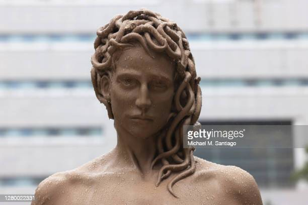 "Detailed view of Medusa's head from the newly installed statue of ""Medusa With The Head of Perseus"" by Argentine-Italian artist Luciano Garbati..."