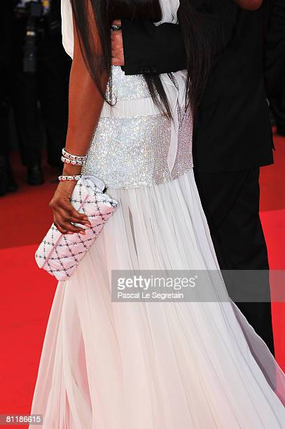 Detailed view of model Naomi Campbell's clutch bag as she arrives at the 'Che' Premiere at the Palais des Festivals during the 61st International...