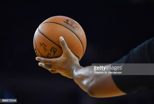 A detailed view of NBA referee Kevin Cutler holding up an official Spalding basketball during an NBA game between the Portland Trail Blazers and...