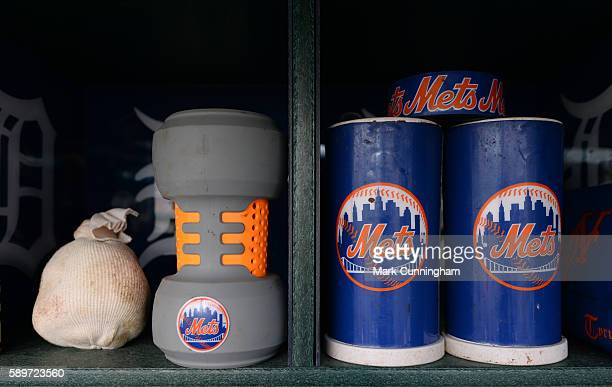 A detailed view of New York Mets baseball bat weights and rosin bag sitting in the dugout prior to the game against the Detroit Tigers at Comerica...